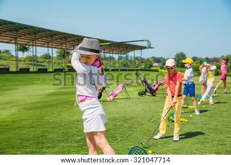 Kids warming up at golf school at summer day - stock photo