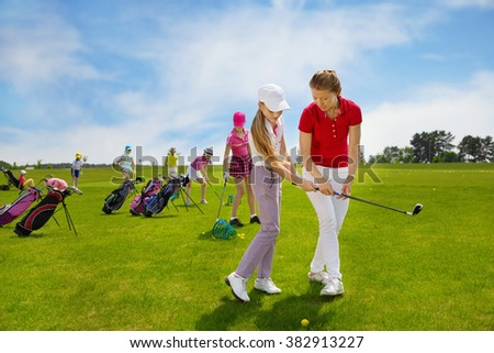 Kids warming up at golf school at summer day