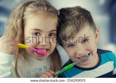 Kids washing teeth.