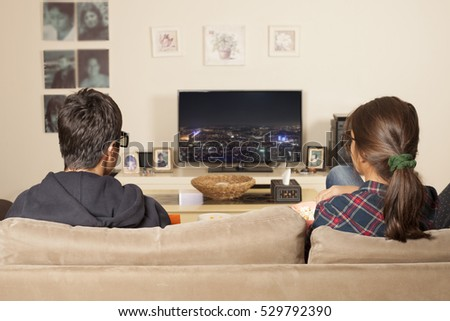 kids watching tv at home