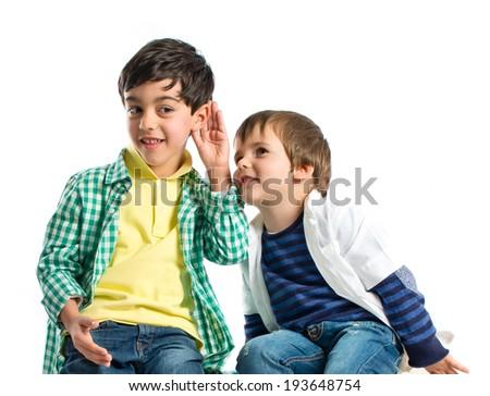 Kids whispering over white background  - stock photo