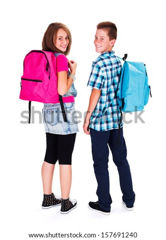 Kids with backpack on looking back and smiling happily