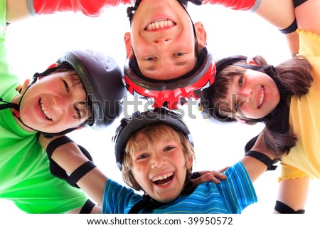 Kids with helmets and pads - stock photo