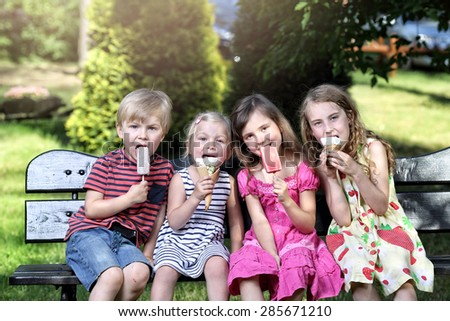 Kids with ice cream in hot summer day - stock photo