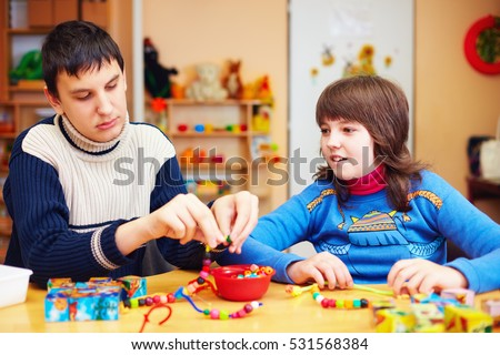 kids with special needs develop their fine motor skills in daycare rehabilitation center