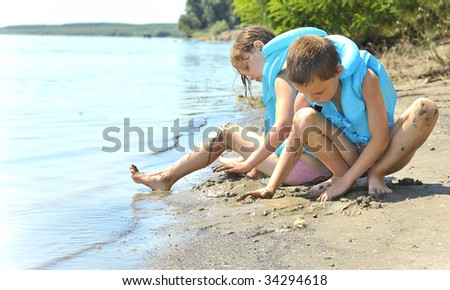 Kids with swimming vest - stock photo