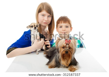 kids with the little dogs