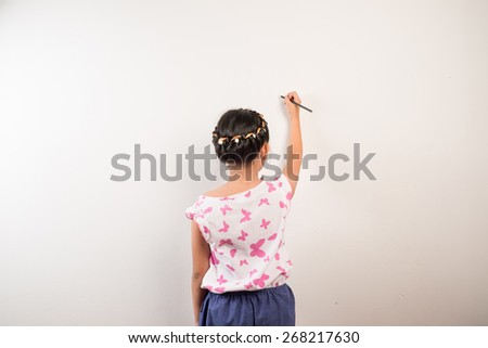 kids writing on white board - stock photo
