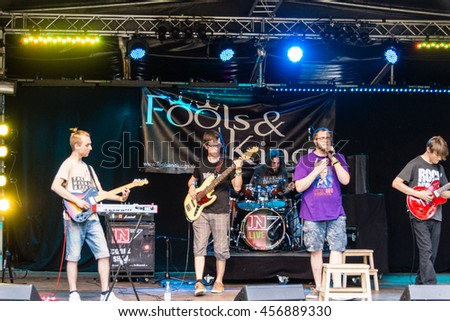 "Kiel, Germany - June 23rd 2016: The Band ""Fools & Kings"" performs on the Junge Bühne during the sixth Day of the Kieler Woche 2016"