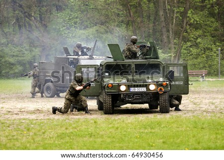 KIELCE - MAY 3. Polish soldiers during military performance during ceremony of Constitution of May 3, 1791 - May 3, 2010 in Kielce, forest near Kusocinskiego Street, Poland. - stock photo