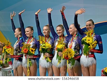 KIEV - AUG 31: Belarus gymnasts on medal award ceremony during 32nd Rhythmic Gymnastics World Championships on August 31, 2013 in Kiev, Ukraine.  - stock photo