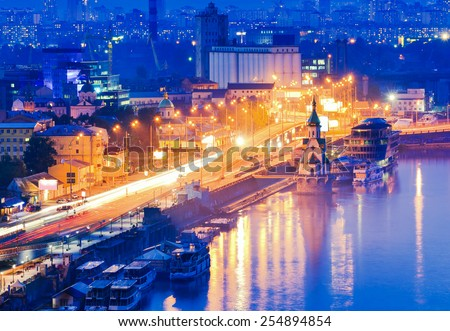 Kiev city, Capital of Ukraine. Night View of the Dnieper river, River station, an old embankment and Church of Saint Nicholas (on the water) in Kyiv. - stock photo