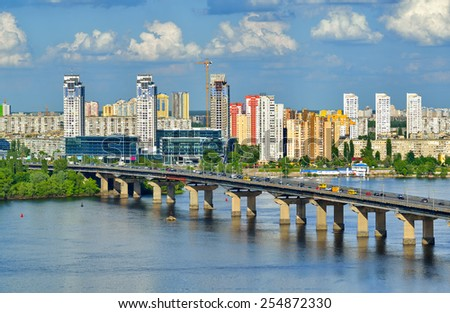 Kiev city, Capital of Ukraine. View of the Dnieper river, Paton bridge and new buildings in Kyiv - stock photo