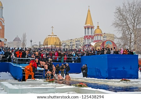 KIEV-JAN 19: Epiphany near Svjato-Pokrovskiy Cathedral on January 19,2013 in Kiev,Ukraine.People plunging into ice-cold water as it helps body became resilient to illness.Epiphany known since 988 AD. - stock photo