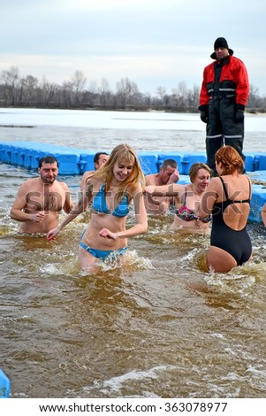 KIEV-JAN 19: Epiphany near Svjato-Pokrovskiy Cathedral on January 19,2014 in Kiev,Ukraine.People plunging into ice-cold water as it helps body became resilient to illness.Epiphany known since 988 AD.