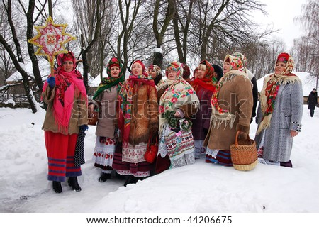KIEV - JANUARY 8: Folk Ukrainian Group celebrating Christmas Day in open air Museum of Folk Architecture and Rural Life PYROGOVO, January 8, 2010 in Kyiv, Ukraine - stock photo