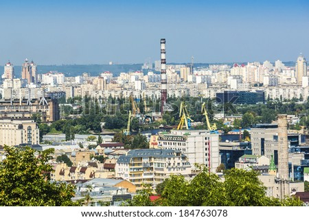 KIEV (KYIV), UKRAINE - AUGUST 20, 2013: Kiev cityscape: view of Left Bank of River Dnieper. Kiev is capital of Ukraine and one of oldest cities of Eastern Europe. Kiev was founded in late 9th century.