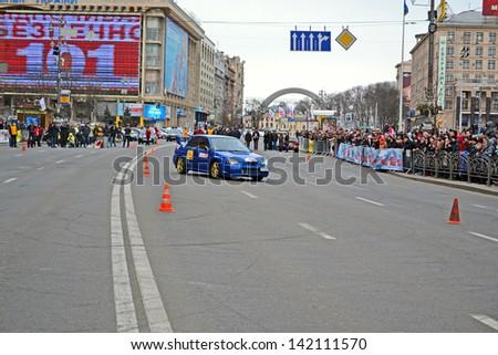 KIEV - MAR 08: Woman sport car rally show on Kreshatik in Kiev, Ukraine on March 08, 2013. Show organized by Kyiv City Autoclub and Automobile Federation of Ukraine. - stock photo