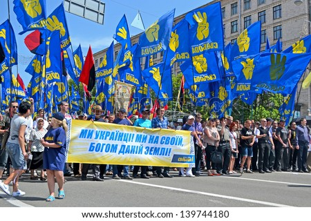 KIEV - MAY 18: Political meeting on May 18, 2013 in Kiev, Ukraine. Representatives of Svoboda (Freedom) party on the street. About 50000 people take part in the event in Kiev. - stock photo