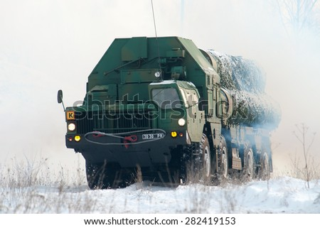 KIEV REGION, UKRAINE - 14 NOVEMBER 2007. Launcher missile air defense systems S-300 goes into the firing position.
