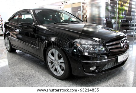 "KIEV - SEPTEMBER 10: Black Mercedes-Benz C-class at Yearly automotive-show ""Capital auto show 2010"". September 10, 2010 in Kiev, Ukraine. - stock photo"