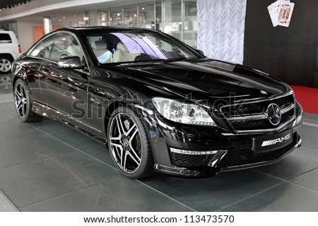 "KIEV - SEPTEMBER 7: Black Mercedes-Benz SL 63 AMG at yearly automotive-show ""Capital auto show 2012"". September 7, 2012 in Kiev, Ukraine - stock photo"