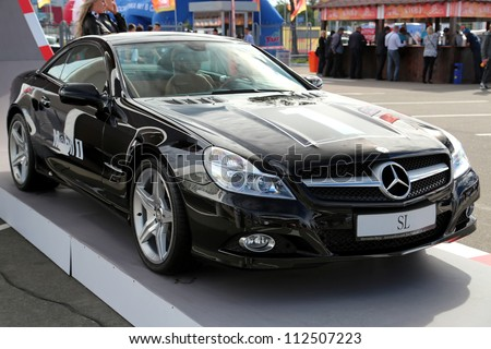 "KIEV - SEPTEMBER 7: Black Mercedes-Benz SL-class at yearly automotive-show ""Capital auto show 2012"". September 7, 2012 in Kiev, Ukraine"