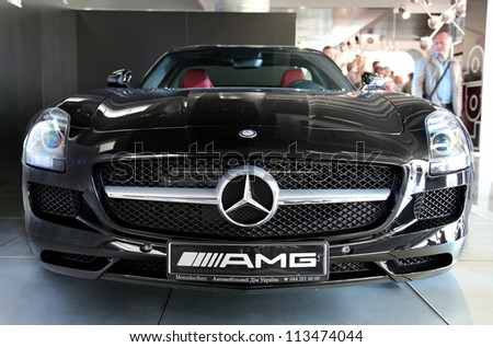 "KIEV - SEPTEMBER 7: Black Mercedes-Benz SLS AMG at yearly automotive-show ""Capital auto show 2012"". September 7, 2012 in Kiev, Ukraine"