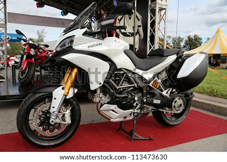 "KIEV - SEPTEMBER 7: Ducati motorcycle at yearly automotive-show ""Capital auto show 2012"". September 7, 2012 in Kiev, Ukraine - stock photo"