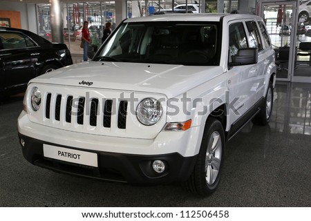"KIEV - SEPTEMBER 7: Jeep Patriot at yearly automotive-show ""Capital auto show 2012"". September 7, 2012 in Kiev, Ukraine - stock photo"