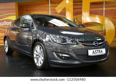 "KIEV - SEPTEMBER 7: Opel Astra Eco Flex at yearly automotive-show ""Capital auto show 2012"". September 7, 2012 in Kiev, Ukraine - stock photo"