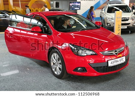 "KIEV - SEPTEMBER 7: Opel Astra GTC at yearly automotive-show ""Capital auto show 2012"". September 7, 2012 in Kiev, Ukraine"