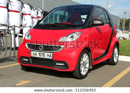 "KIEV - SEPTEMBER 7: Red Smart at yearly automotive-show ""Capital auto show 2012"". September 7, 2012 in Kiev, Ukraine"