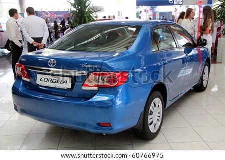 "KIEV - SEPTEMBER 10: Yearly automotive-show ""Capital auto show 2010"". September 10, 2010 in Kiev, Ukraine. Blue Toyota Corolla - stock photo"