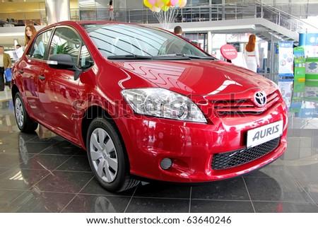 "KIEV - SEPTEMBER 10: Yearly automotive-show ""Capital auto show 2010"". September 10, 2010 in Kiev, Ukraine. Red Toyota Auris - stock photo"