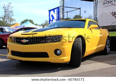 "KIEV - SEPTEMBER 10: Yearly automotive-show ""Retro auto show 2010"". September 10, 2010 in Kiev, Ukraine. Yellow Chevrolet Camaro - stock photo"