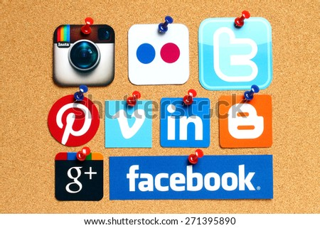 KIEV, UKRAINE - APRIL 15, 2015: Collection of popular social media logos printed on paper:Facebook, Twitter, Google Plus, Instagram, Flickr, Linked In, Pinterest, Vimeo and Blogger on cork background - stock photo