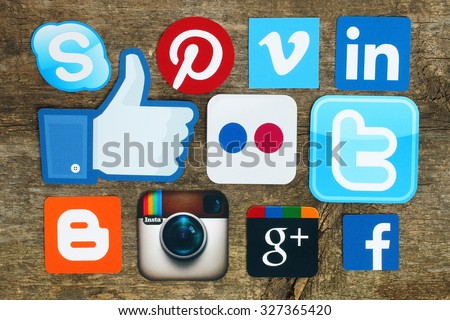 Kiev, Ukraine - April 15, 2015:Collection of popular social media logos printed on paper:Facebook, Twitter, Google Plus, Instagram, Skype, Pinterest and Blogger on old wooden background