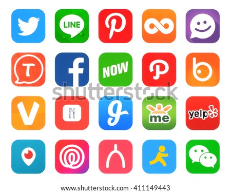 Kiev, Ukraine - April 22, 2016: Collection of popular 20 social networking icons, printed on paper, such as: Facebook, Twitter, Pinterest, Twoo, Periscope and others