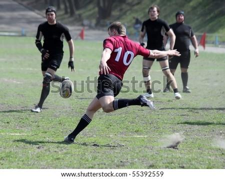 KIEV, UKRAINE - APRIL 18: Dmitriy Kulichko in action at a Ukrainian National Championship rugby match, Eger vs. Antares, April 18, 2010 in Kiev, Uktaine. - stock photo