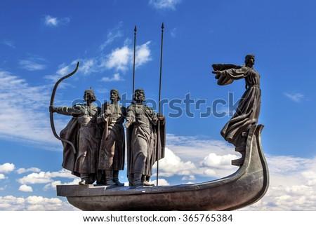 KIEV, UKRAINE - APRIL 18, 2015 Founders Monument Dniper River Kiev Symbol Kiev Ukraine.  Prince Kiy Builder Khoriv SisterLibed Sculptor Boroday 1982 - stock photo