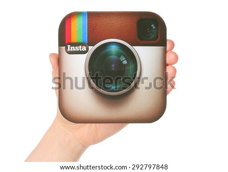 KIEV, UKRAINE - APRIL 29, 2015:Hand holds Instagram logotype printed on paper. Instagram is an online mobile photo-sharing, video-sharing service. - stock photo