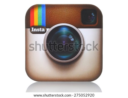 KIEV, UKRAINE - APRIL 29, 2015:Instagram logotype camera printed on paper and placed on white background. Instagram is an online mobile photo-sharing, video-sharing service. - stock photo