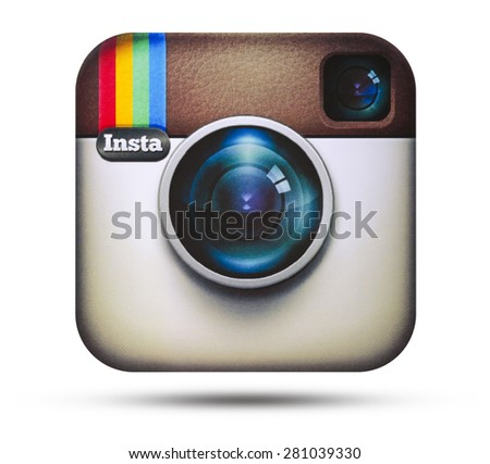 KIEV, UKRAINE - APRIL 16, 2015:Instagram logotype camera printed on paper. Instagram - free application for sharing photos and videos with the elements of a social network. - stock photo