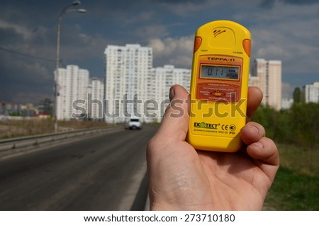 Kiev, Ukraine -April 29, 2015: Measuring radiation levels in the residential area of Kiev after huge forest wildfire in Chernobyl Area on April 28. Kiev April 29,, 2015  Kiev, Ukraine. - stock photo
