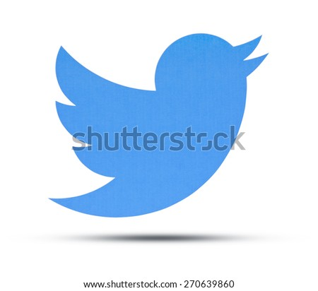 KIEV, UKRAINE - APRIL 16, 2015: Twitter logotype printed on paper. Twitter social network for public exchange of short messages using the web interface, SMS, instant messaging tools - stock photo