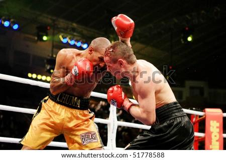 KIEV, UKRAINE - APRIL 19: WBA welterweight belt holder Yuriy Nuzhnenko(R) throws a punch against Irving Garcia during their WBA World Welterweight Title fight on April 19, 2008 in Kyiv, Ukraine - stock photo