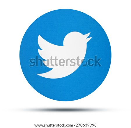 KIEV, UKRAINE - APRILE 16, 2015: Twitter logotype printed on paper. Twitter social network for public exchange of short messages using the web interface, SMS, instant messaging tools. - stock photo