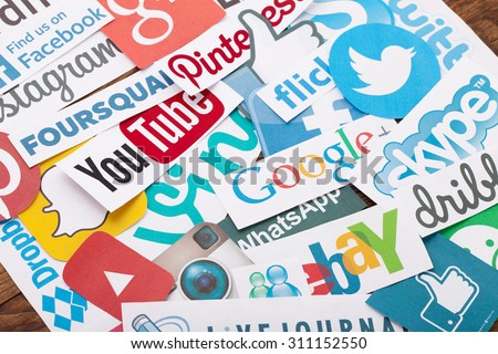 KIEV, UKRAINE - AUGUST 22, 2015:Collection of popular social media logos printed on paper:Facebook, Twitter, Google Plus, Instagram, Pinterest, Skype, YouTube, Linkedin and others on wooden background - stock photo