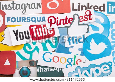 KIEV, UKRAINE - AUGUST 22, 2015:Collection of popular social media logos printed on paper:Facebook, Twitter, Google Plus, Instagram, Pinterest, Skype, YouTube, Linkedin and others on wooden background